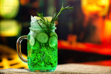 Closeup jar of cucumber and tarragon lemonade served at bar background. Stock Photo
