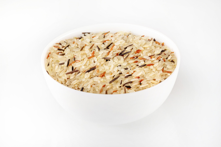 Bowl of mixed rice isolated at white background.