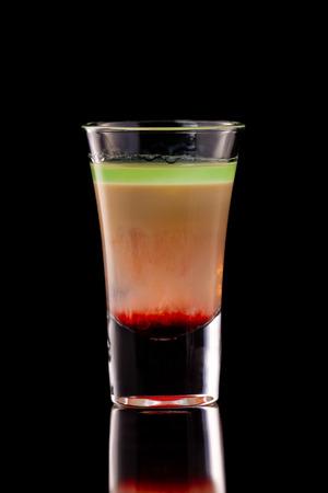 Hiroshima alcohol layered shooter cocktail isolated at black background. Standard-Bild - 111416068