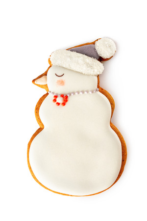 Closeup gingerbread christmas snowman cookie isolated at white background.