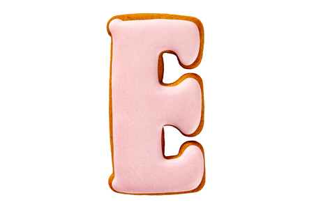 Gingerbread pink letter E cookie isolated at white background. Stock Photo