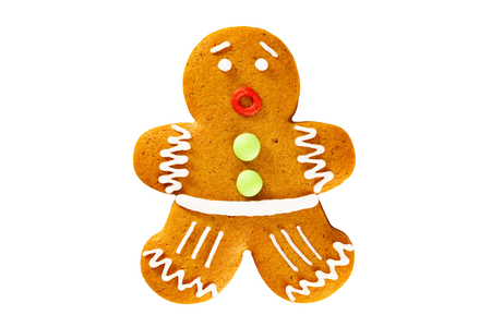 Closeup angry xmas gingerbread man cookie isolated at white background.