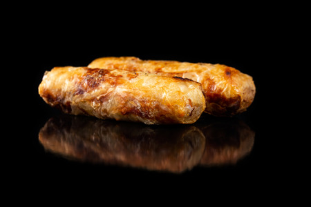 Macro image of traditional vietnamese food  - cha gio spring rolls isolated at black background.