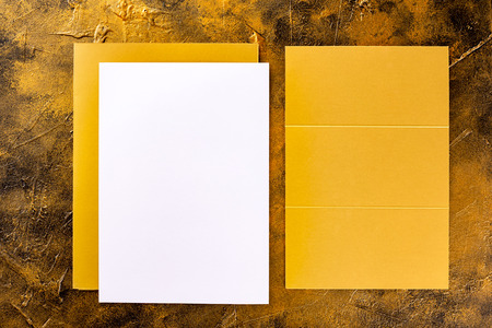 Brand identity mockup. Blank golden foil corporate stationery set of letterhead, closed presentation folder and three fold brochure at golden textured background. Imagens