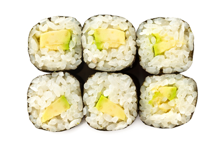 Top view closeup japanese classic sushi rolls with avocado isolated at white background. Imagens