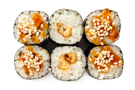 Top view closeup japanese classic sushi rolls with tuna served with teriyaki isolated at white background.