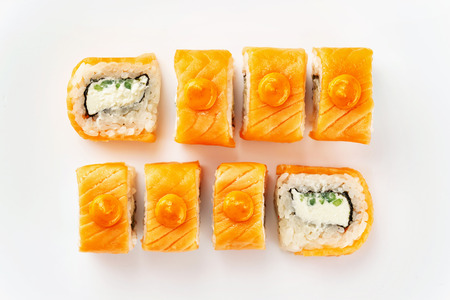 Closeup top view set of japanese philadelphia sushi rolls with salmon isolated at white background.