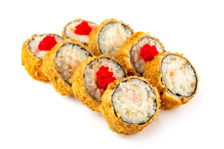 Closeup set of tempura fried sushi rolls with tobico and shrimps isolated at white background.