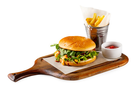Closeup fastfood set of homemade burger, french fries and ketchup at wooden board isolated at white background. Stok Fotoğraf