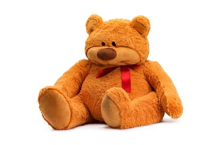 Image of brown toy teddy bear sitting at white isolated background. Imagens
