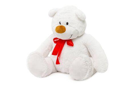 Image of white toy teddy bear sitting at isolated white background. Reklamní fotografie