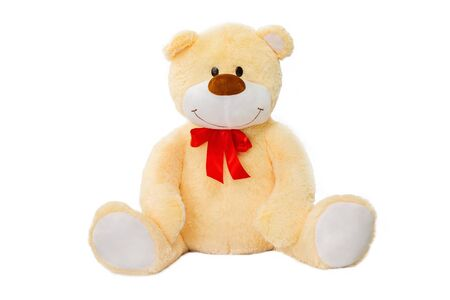 Image of golden toy teddy bear sitting at isolated white background.