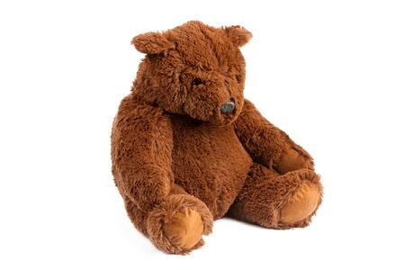 Image of brown toy ugly eddy bear sitting at white isolated background. Reklamní fotografie