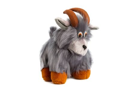 Closeup image grey toy soft goat with grey fur isolated at white background. Фото со стока
