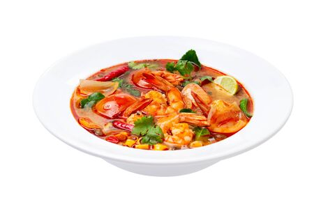 Closeup plate of traditional thai soup - tom yum kung with shrimps and tomatoes isolated at white background. Stock fotó