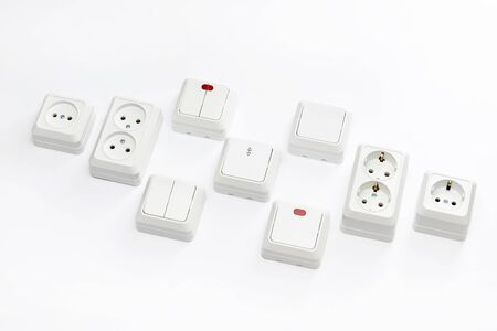 Group of electic sockets and switchers isolated at white background.