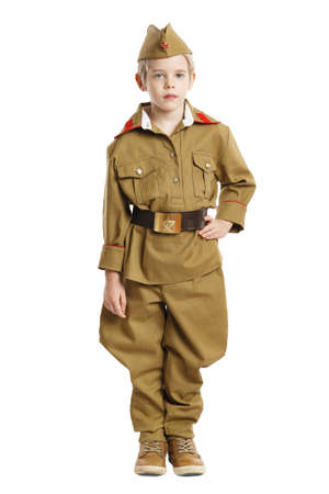 Portrait of pretty boy in ussr military uniform isolated at white background. Concept of russian soldier for 9 May holiday celebration. 写真素材