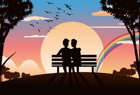 An image of two  lovers sitting on a park bench and watching the sunset Stock Photo