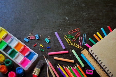 learing: School supply on a black background for education