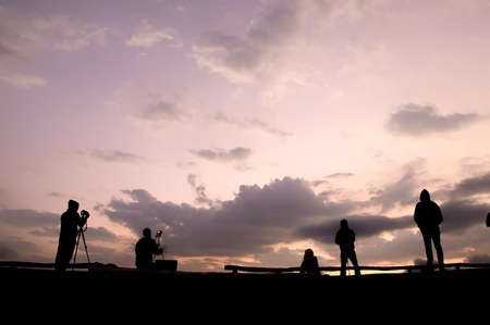 Silhouette of photographer waiting for the sunrise on the hill Banco de Imagens