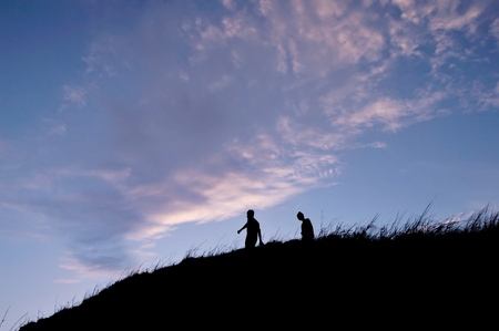 Silhouette of people walking on the hill at mountain Banco de Imagens