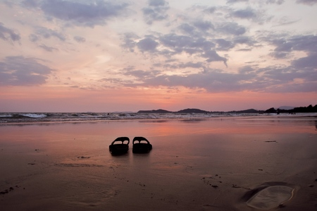 Slipper on the beach with sunset sky