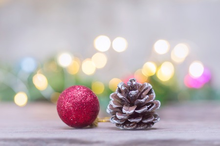 Close up of red ball and pinecone for Christmas or New Year decoration background
