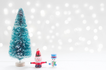 Christmas tree, santa claus and snow man doll for Christmas decoration background