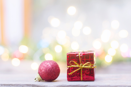 Close up of red ball and red gift box for Christmas or New Year decoration background Banco de Imagens - 123010344