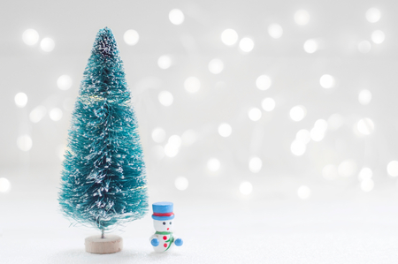 Christmas tree and snow man doll with shiny light for Christmas decoration background