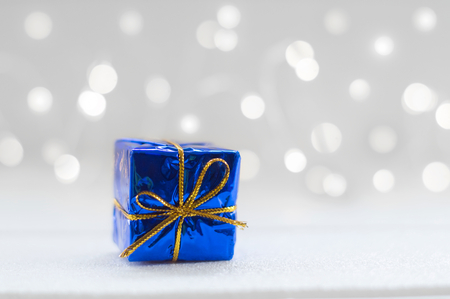 Blue gift box with shiny light for Christmas decoration background Banco de Imagens - 123010350