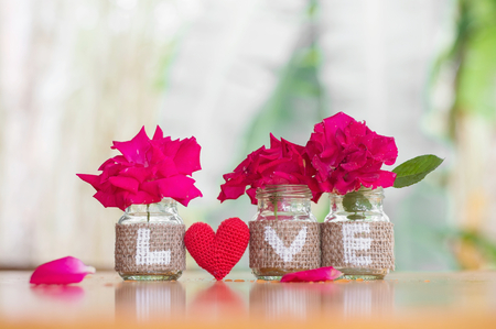 Love on the bottle with rose for Valentine's day or wedding background Banco de Imagens - 123010351