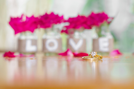 Close up of weeding rings for Valentines day or wedding background