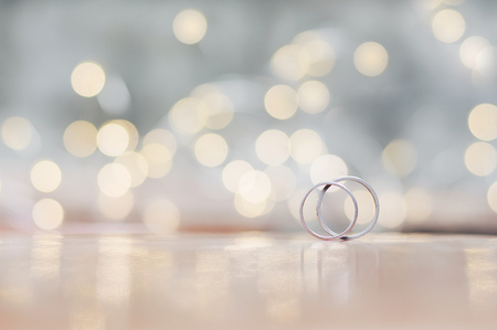 Close up of wedding rings with shiny light for Valentine's day or wedding background Banco de Imagens - 123010354