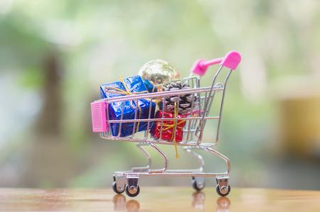 A shopping cart full of Christmas decoration Banco de Imagens