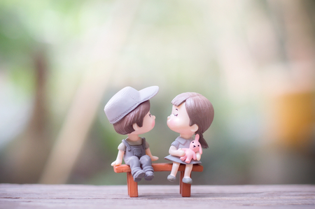 Close up of mini couple dolls in romantic kiss Banco de Imagens - 123010358
