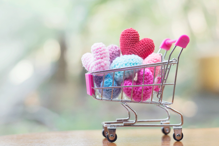 A shopping cart full of heart shape for Valentines day or Wedding concept