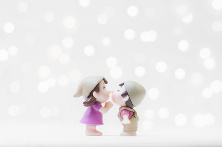 Kissing couple with shiny background for Valentines day or Wedding concept