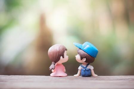 Close up of mini couple dolls in romantic kiss Banco de Imagens - 123010579
