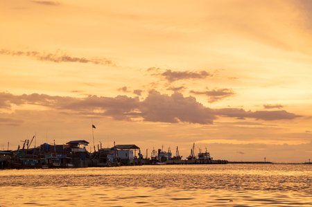 View of fishing village with sunset sky Banco de Imagens