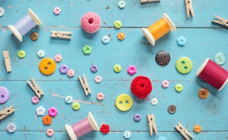 Sewing background. Accessories for needlework on old wooden background. Banco de Imagens - 123010634