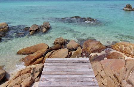 Wooden bridge in to the sea Banco de Imagens - 123010675