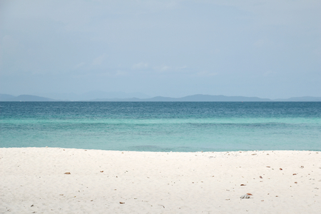 White sand with the blue sea for summer concept Banco de Imagens