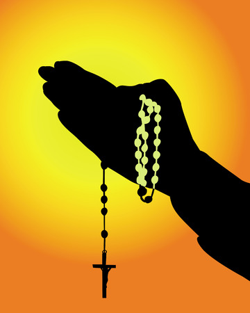 rosary: silhouette of hands with a rosary on an orange background