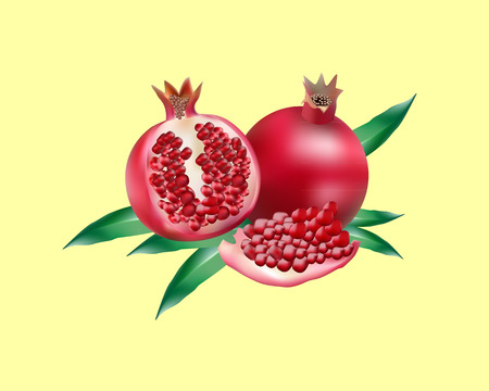 red pomegranate with leaves on a yellow background