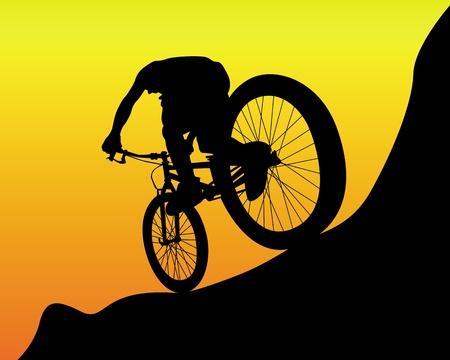 mountain bicycle: silhouette nera di un motociclista della montagna su uno sfondo arancio
