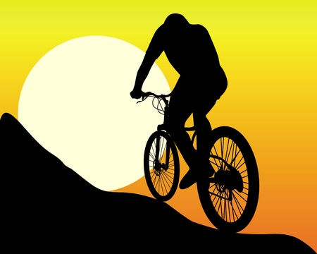 bicycle silhouette: silhouette of a mountain  biker  in the sun and the orange sky
