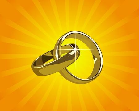wedding gold rings on a background of orange light