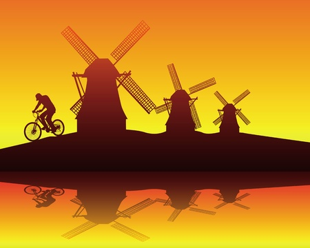 dike: silhouettes of windmills and the rider on an orange background