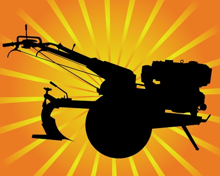 cultivator: motoblock black silhouette on an orange background